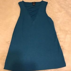 Blue sleeveless top with chest cut out